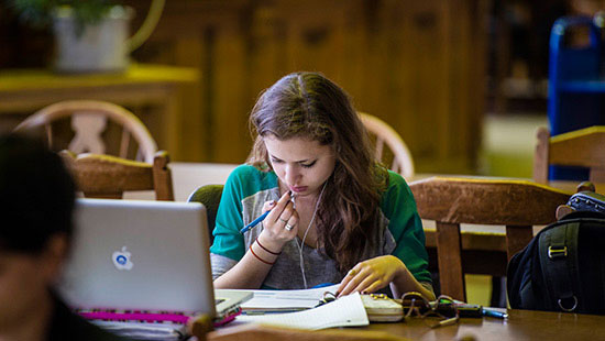 Photo of Student studying in the library