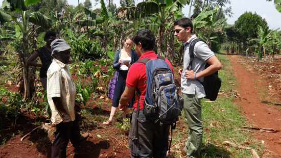 Northwestern students talking with villagers