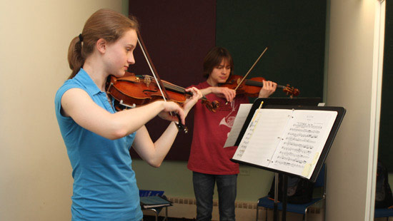 students practicing violins